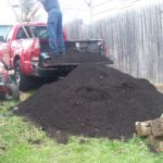 Unloading the compost delivery.