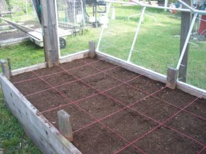 Photo of raised bed after planting seeds.
